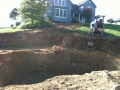 excavating for the 8' tall waterfall