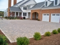 paver parking court with cobble edging
