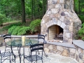 fieldstone fire place with bluestone capped hearth and seat wall