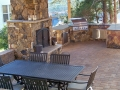 pavilion with fieldstone fire place and outdoor kitchen