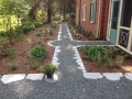 gravel garden path edged with mortared soapstone