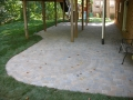 paver patio creating usable space under deck