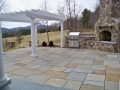 fieldstone fireplace and outdoor kitchen