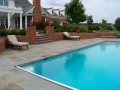 brick retaining walls and bluestone pool terrace