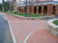fieldstone walls and brick driveways and sidewalks