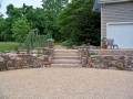 fieldstone retaining walls, prime and seal parking court, and stone slab steps