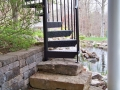 spiral stair with fieldstone slab base