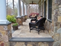 fieldstone porch foundation and piers with bluestone caps, trim and window sills, travertine floorstone porch with fiberglass columns, travertine floor, bluestone caps, trim and window sills